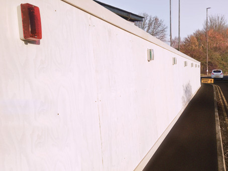 Budget white primed plywood hoarding - security hoarding