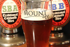 A pint of beer on the bar at The Mount Inn