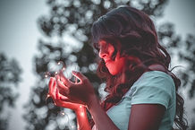 Canva - Woman Holding String Lights.jpg