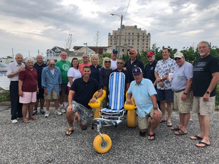 City gets money for, dedicates new beach wheelchair