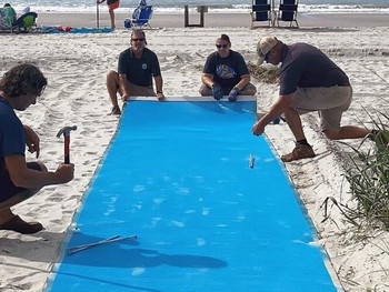 Volunteers install five new wheelchair mats at North Myrtle Beach accesses