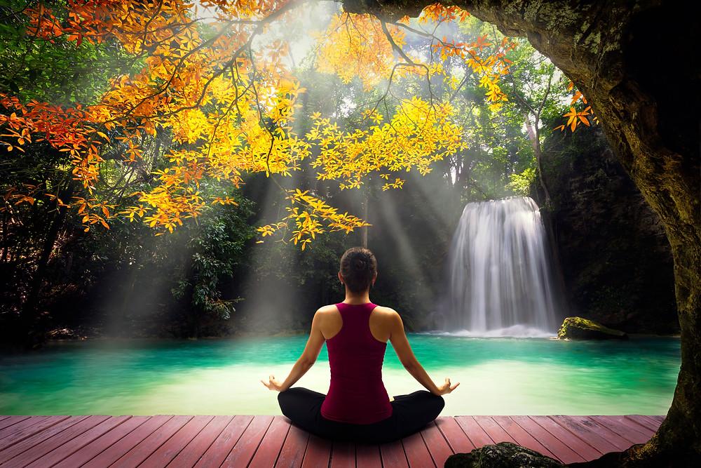woman meditating tree waterfall