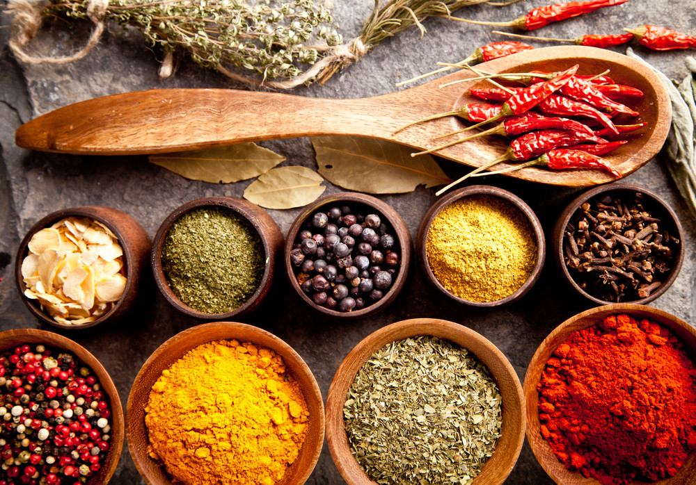 spices and chilies in wooden bowls