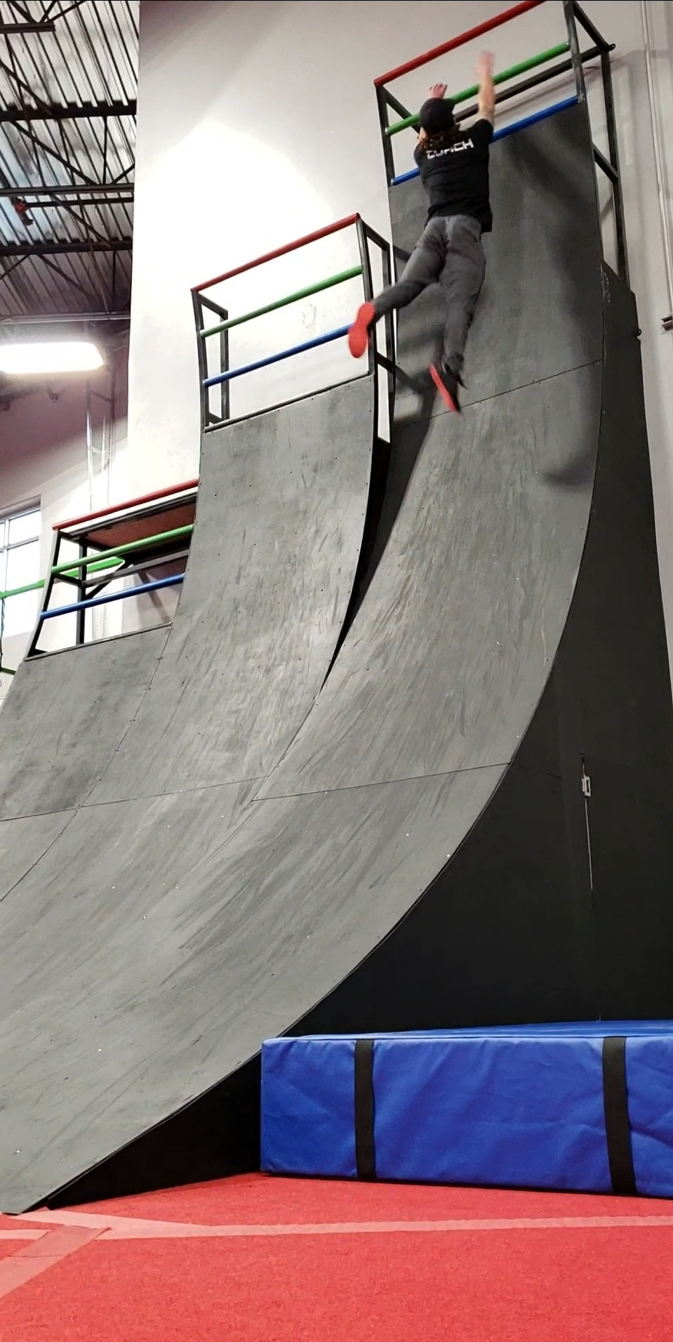 A person attempting the 18 foot Warped Wall.