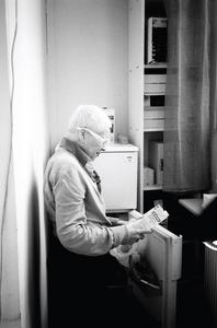 Vivienne checks an organic milk label, Paris, 2014 © www.blackarrowphoto.com