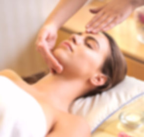 woman-in-wrapped-in-white-towel-lying-on-bed-getting-massage-3757657_edited_edited_edited.jpg
