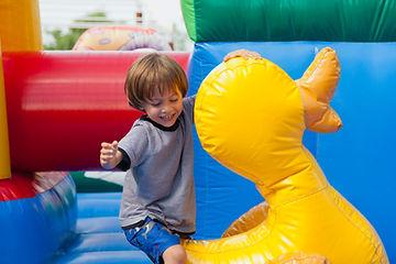 Boy in Bouncy Castle