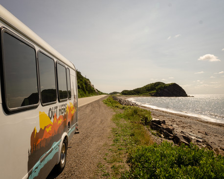 Canada Tour Bus along the coast in Cabot Trail Adventures in Canada.