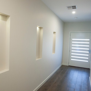 Modern white hallway with timber floors