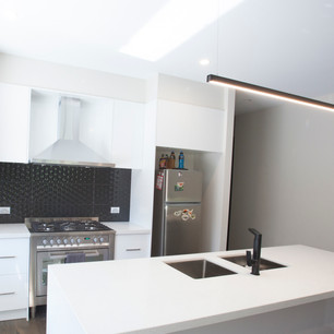New modern home with extended bench and large oven splashback