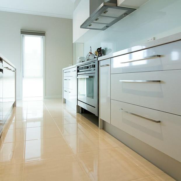 Modern Kitchen Slim Long Silver Handles and Polished Floor Tiles