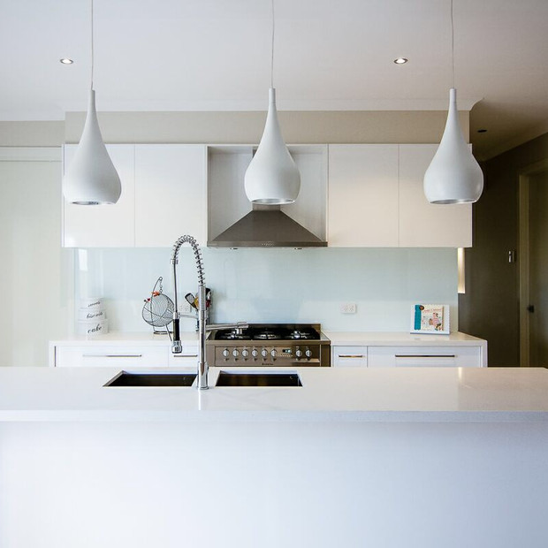 New Kitchen Model Home with drop lights custom modern home