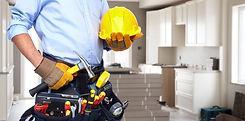 Handyman with a tool belt. House renovat