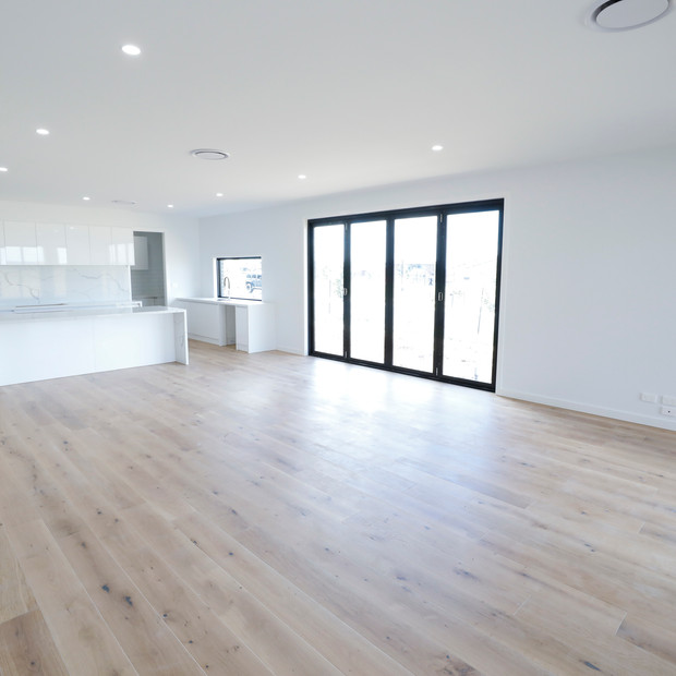 Large area of light wooden floorboards no furniture
