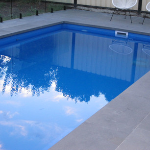 New Modern Pool with grey outdoor rectangle tiles