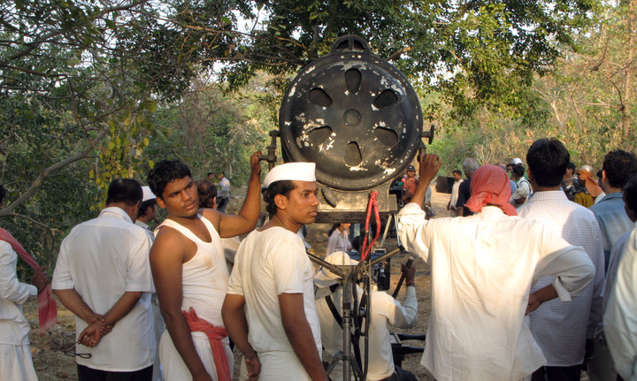 Lighting technicians on location at a set in Film City in Mumbai