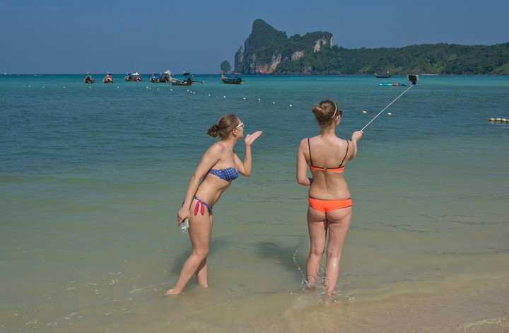 Selfies on a beach at Phi Phi islands in Thailand