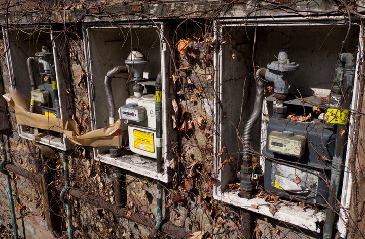 Old and rusty gas meters in a derelict housing estate in Birmingham