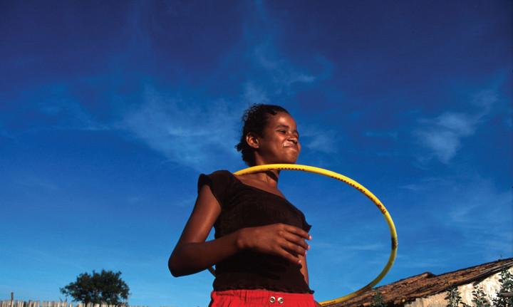 Young woman trying an hula hoop in Venezuela