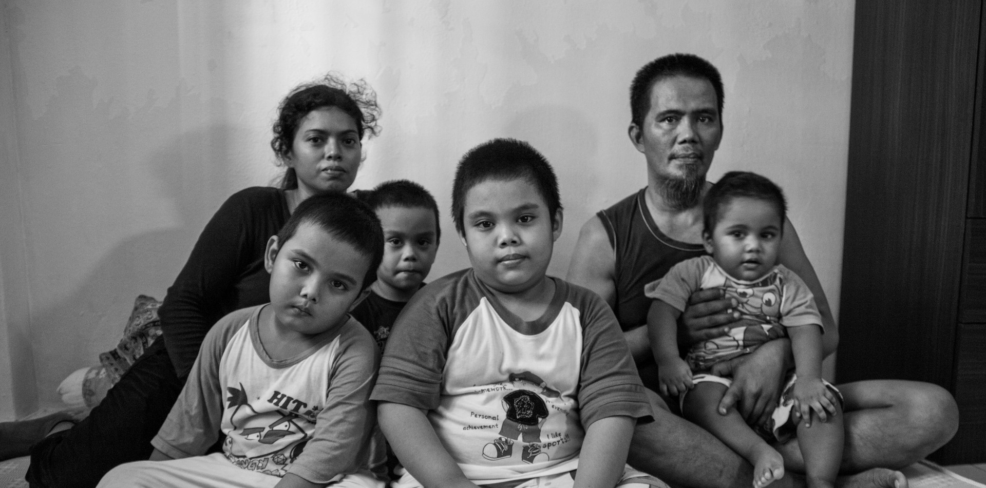 Image of low income families for poverty awareness campaign in Singapore