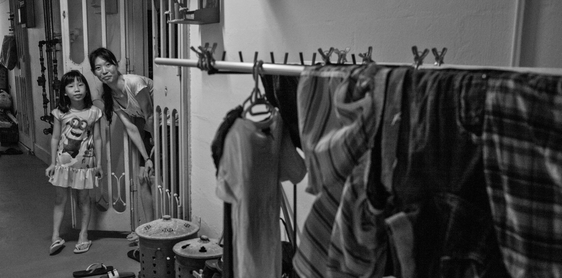 Single mother and daughter in emergency housing in Singapore