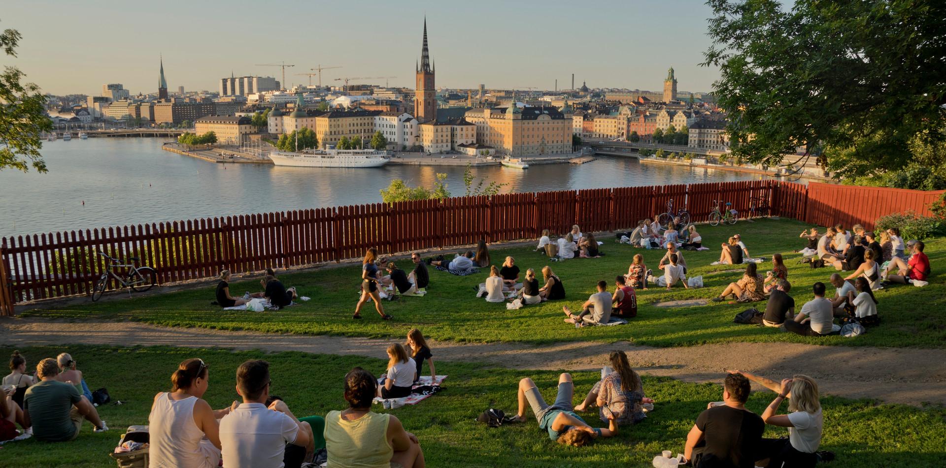 Picnics at sunset in the summer in Stockholm, Sweden