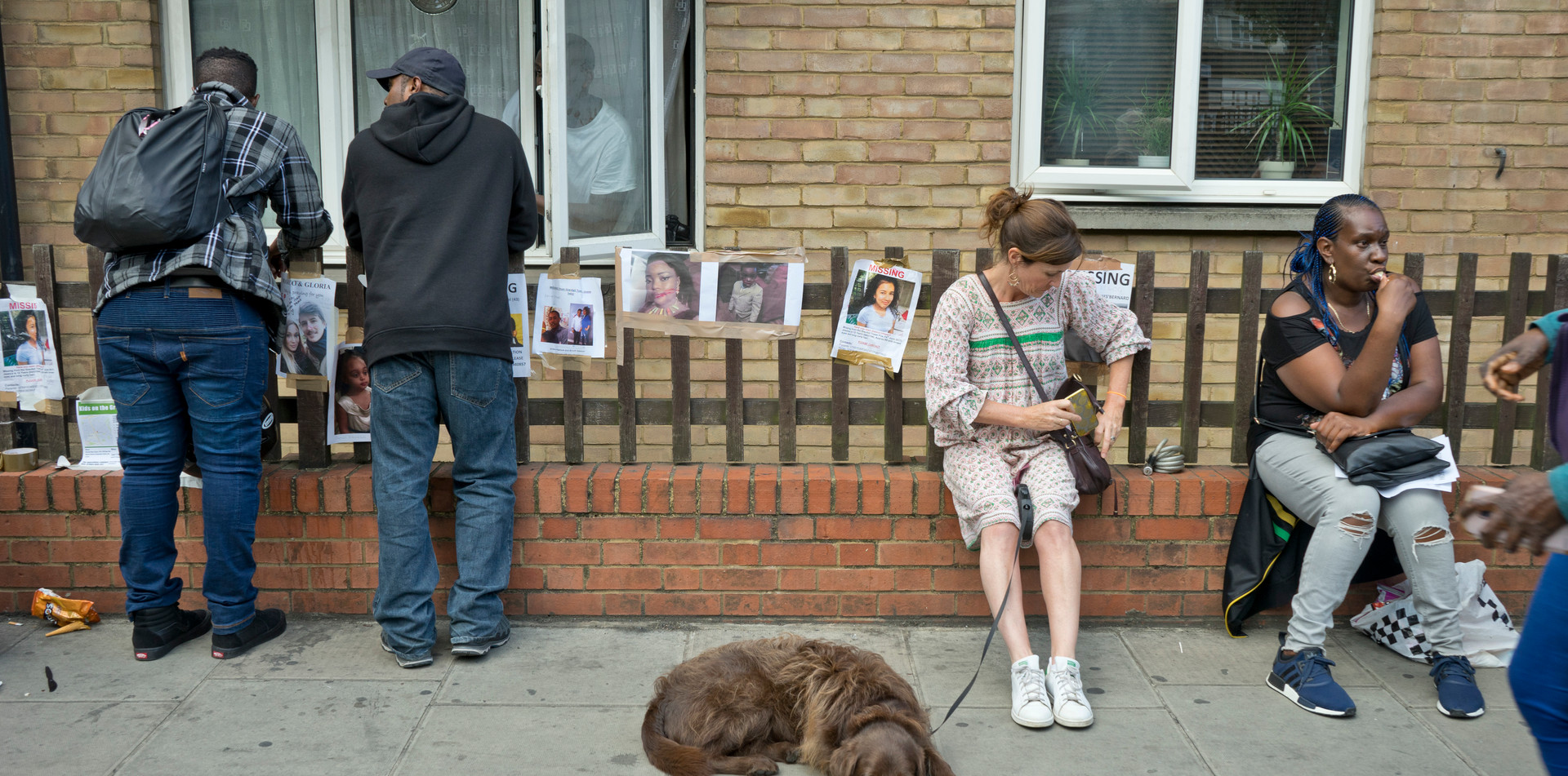 Local residents near site of the fire disaster at the Grenfell Tower in London