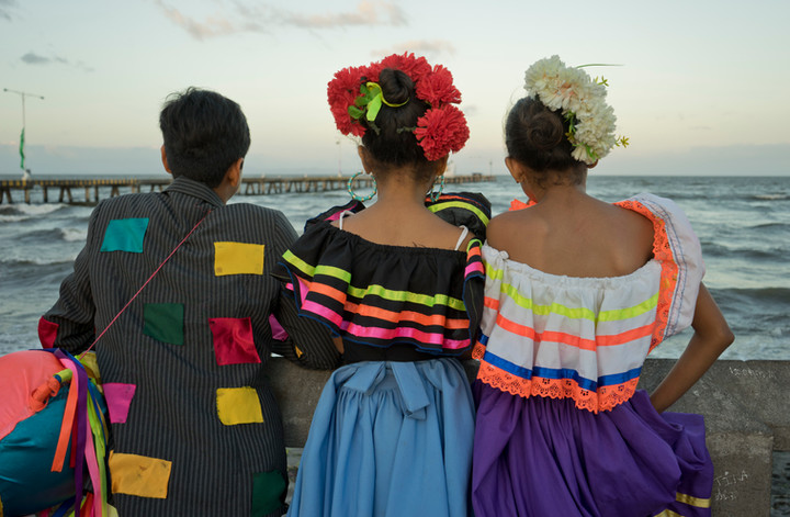 Young people in traditional costumes in by Lake Nicaragua