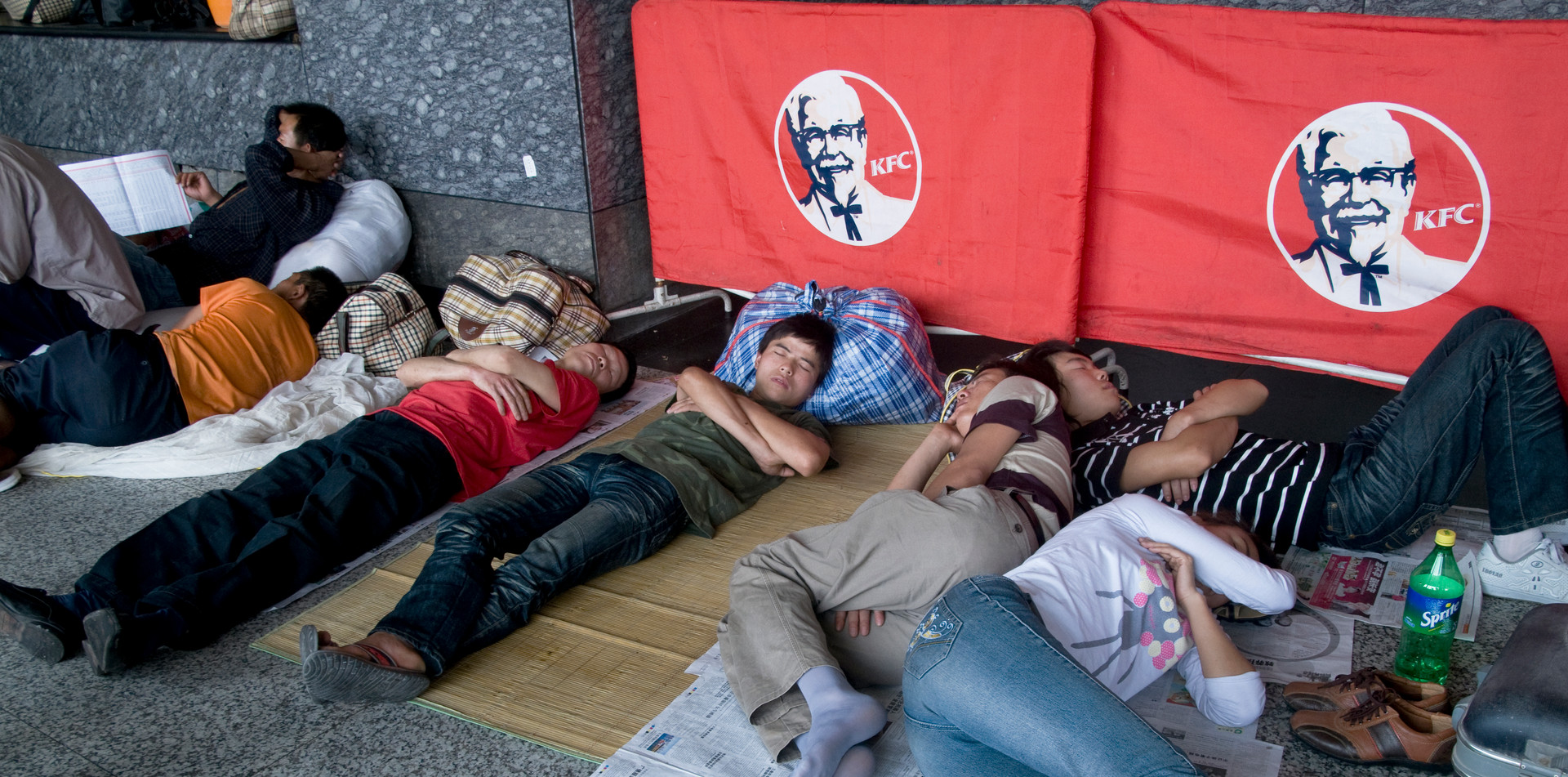 Migrant workers from the hinterland sleeping in the streets of Guangzhou, China