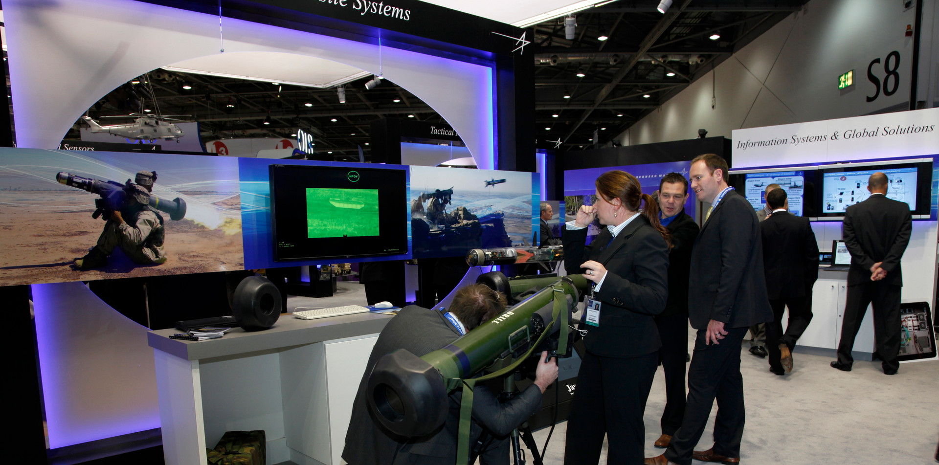 Visitors and traders at an arms fair in London, UK