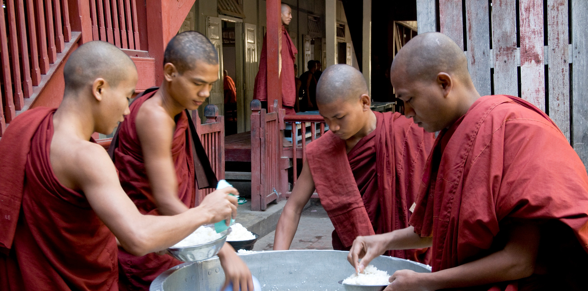 Buddhist monks sharing rice at a monastery at Katha, where George Orwell's 'Burmese Days' was set