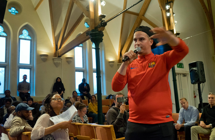 Paul Menacer, 23, survivor of Grenfell Tower fire of 14th June 2017, addressing public meeting of local residents