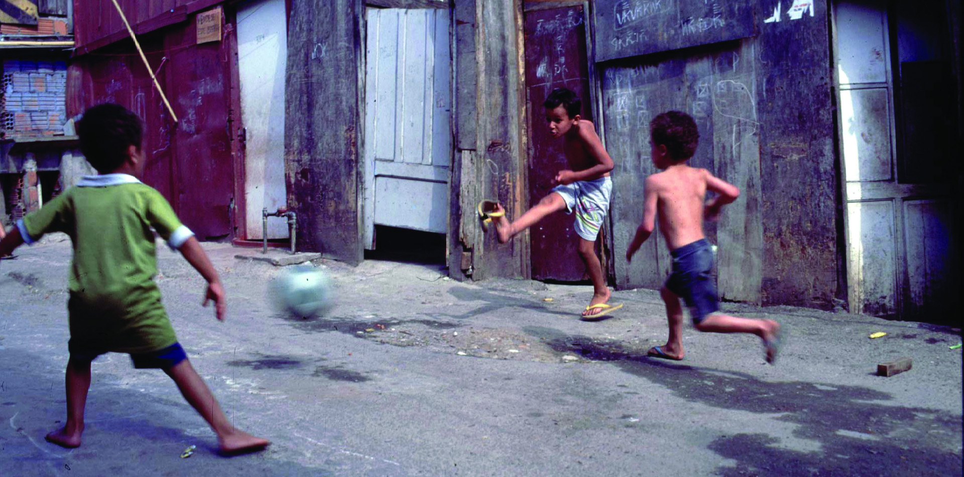 Kids kicking the ball in Santos, near the birthplace of 'King' Pele