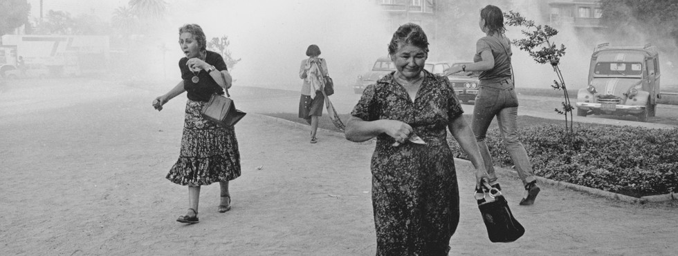 Women attacked by tear gas during Pinochet rule in Chile