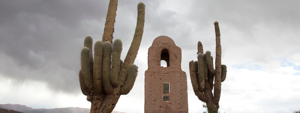 Adobe church and giant cactii in Salta, Argentina