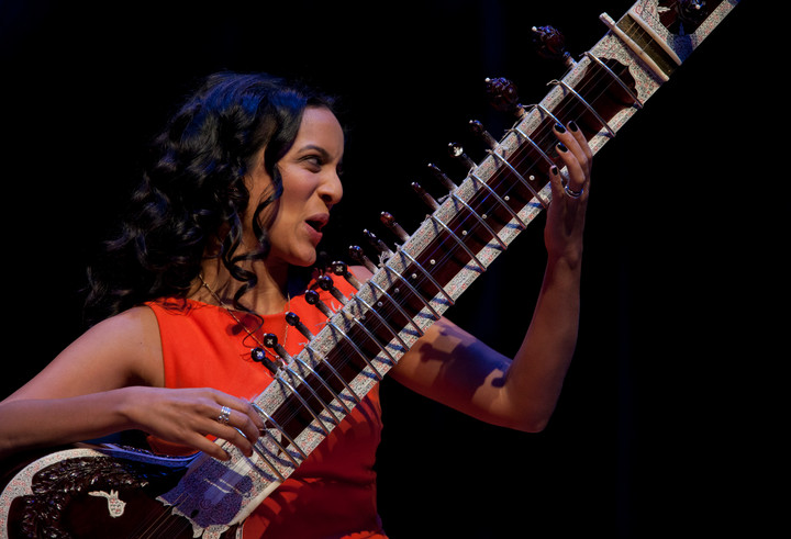 Anoushka Shankar playing the sitar at a festival