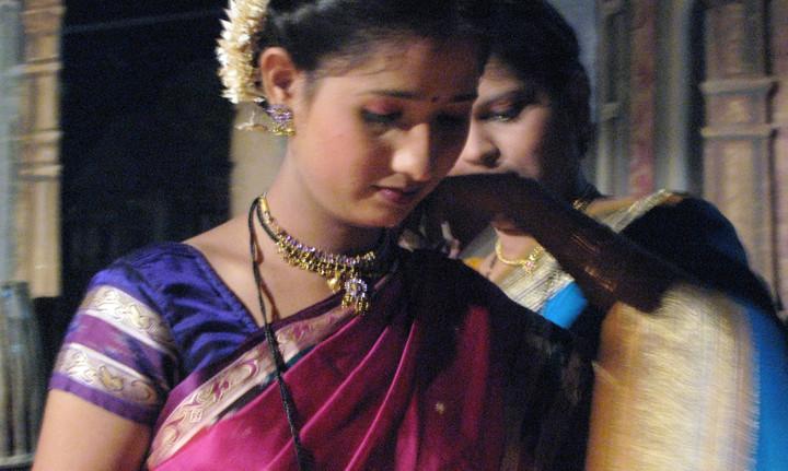 Dancer being dressed at a film studio set in Mumbai