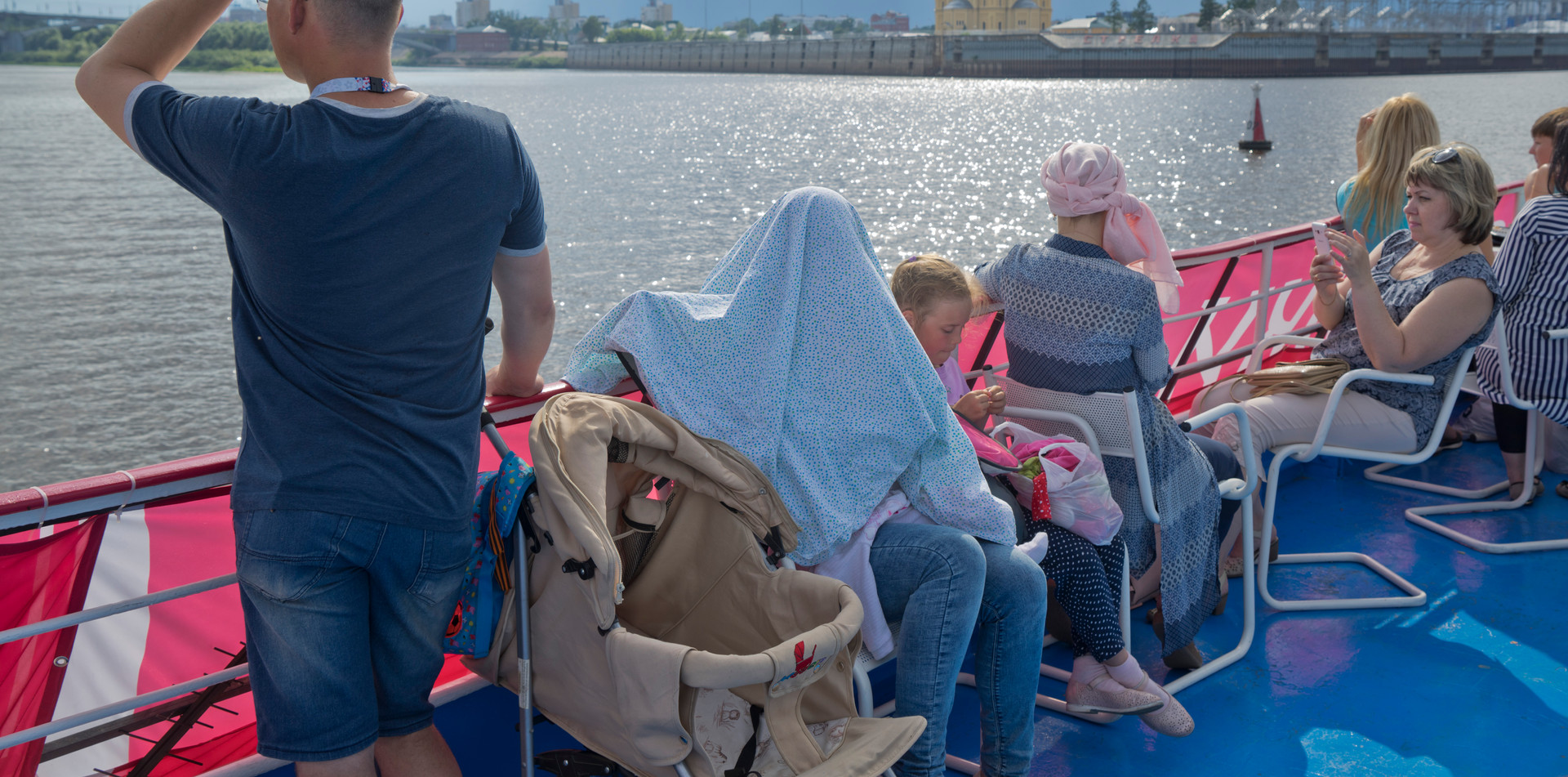 Families on a ferry trip on the Volga river in Nizhny Novgorod, Russia