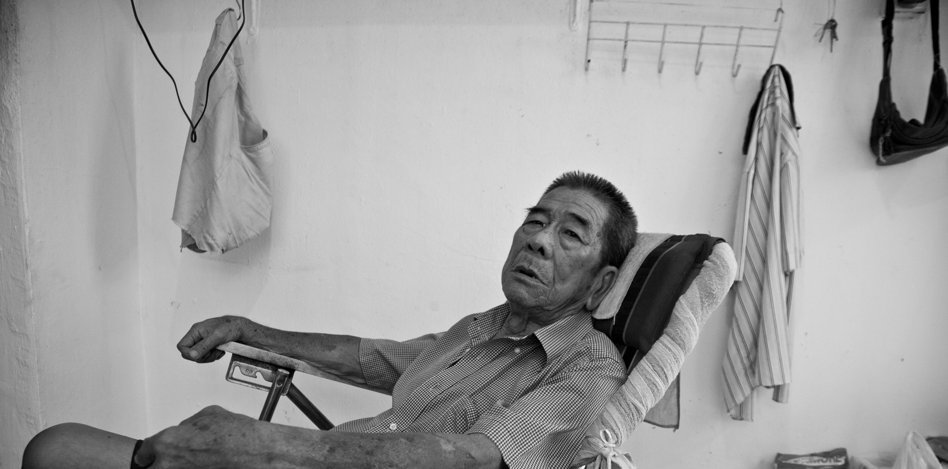 Senior citizen with mental challenges in temporary housing in Singapore