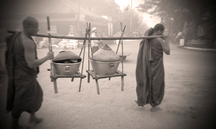 Buddhist monks carrying gifts of rice at Katha, where George Orwell's 'Burmese Days' was set