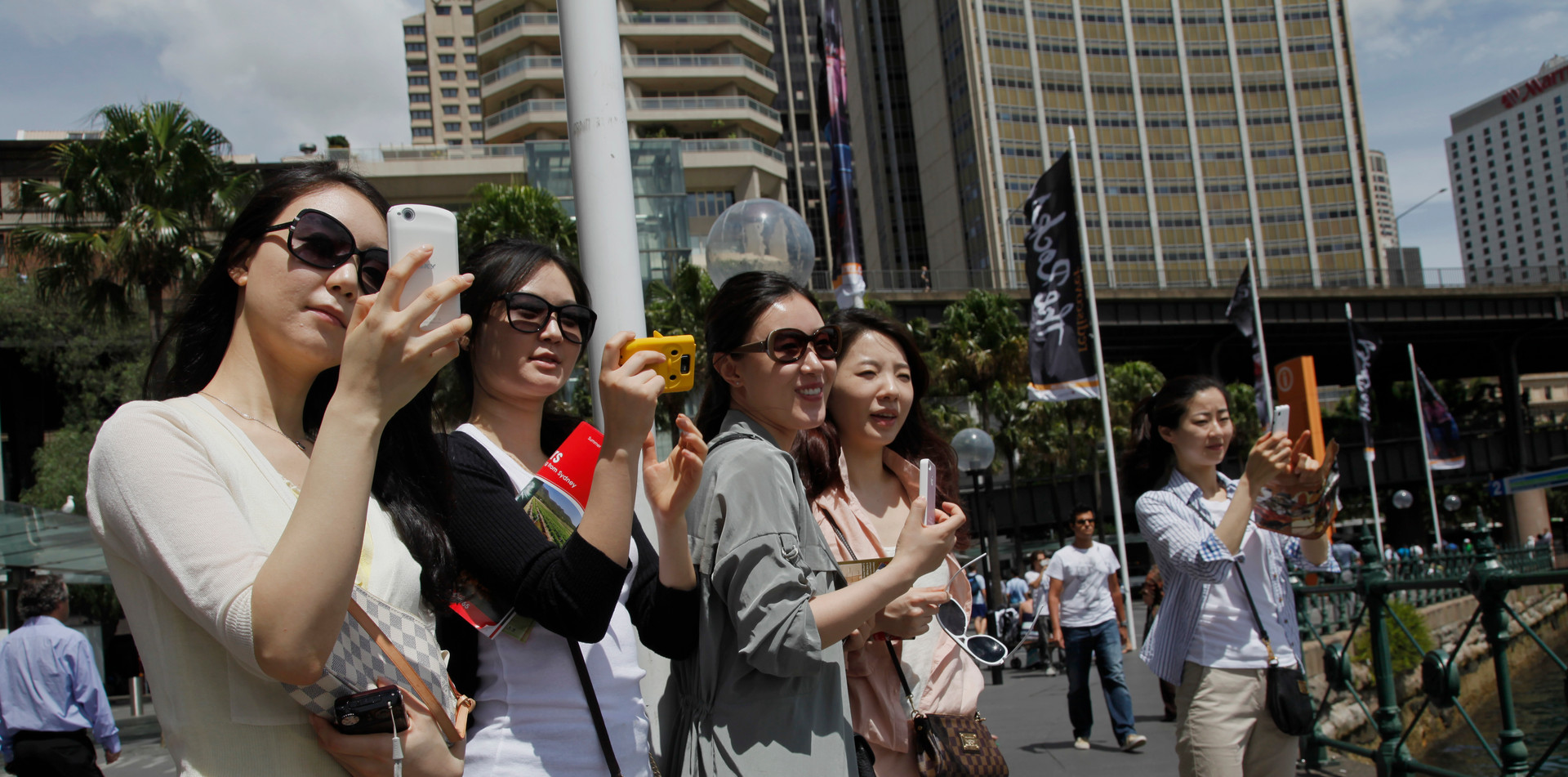 Chinese tourists doing selfies in Sydney, Australia