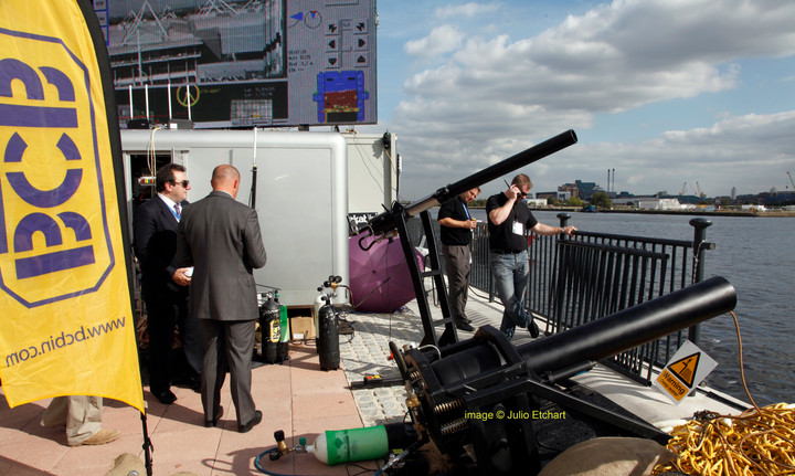 Demonstration of naval guns at an arms fair in London, UK
