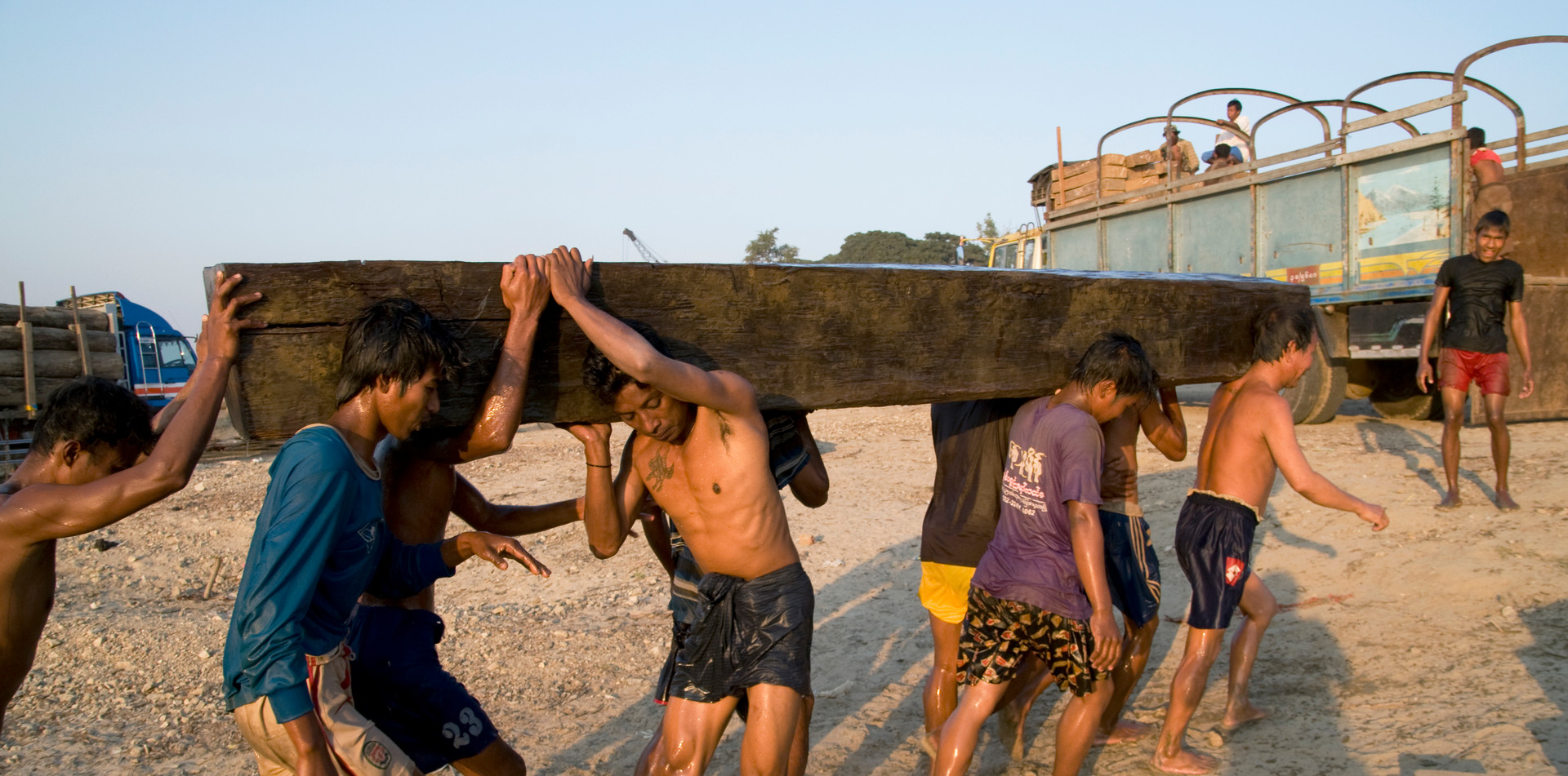 Workers lifting hardwoods near Mandalay, the region where George Orwell's 'Burmese Days' was set