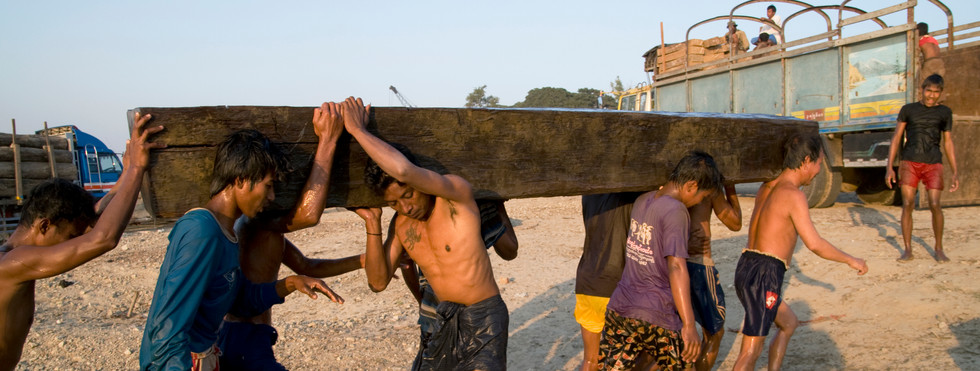 Workers lifting hardwoods near Mandalay, the region where George Orwell's 'Burmese Days' was set