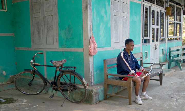Tennis player waiting for partner at the old British Club at Katha, where George Orwell's 'Burmese Days' was set