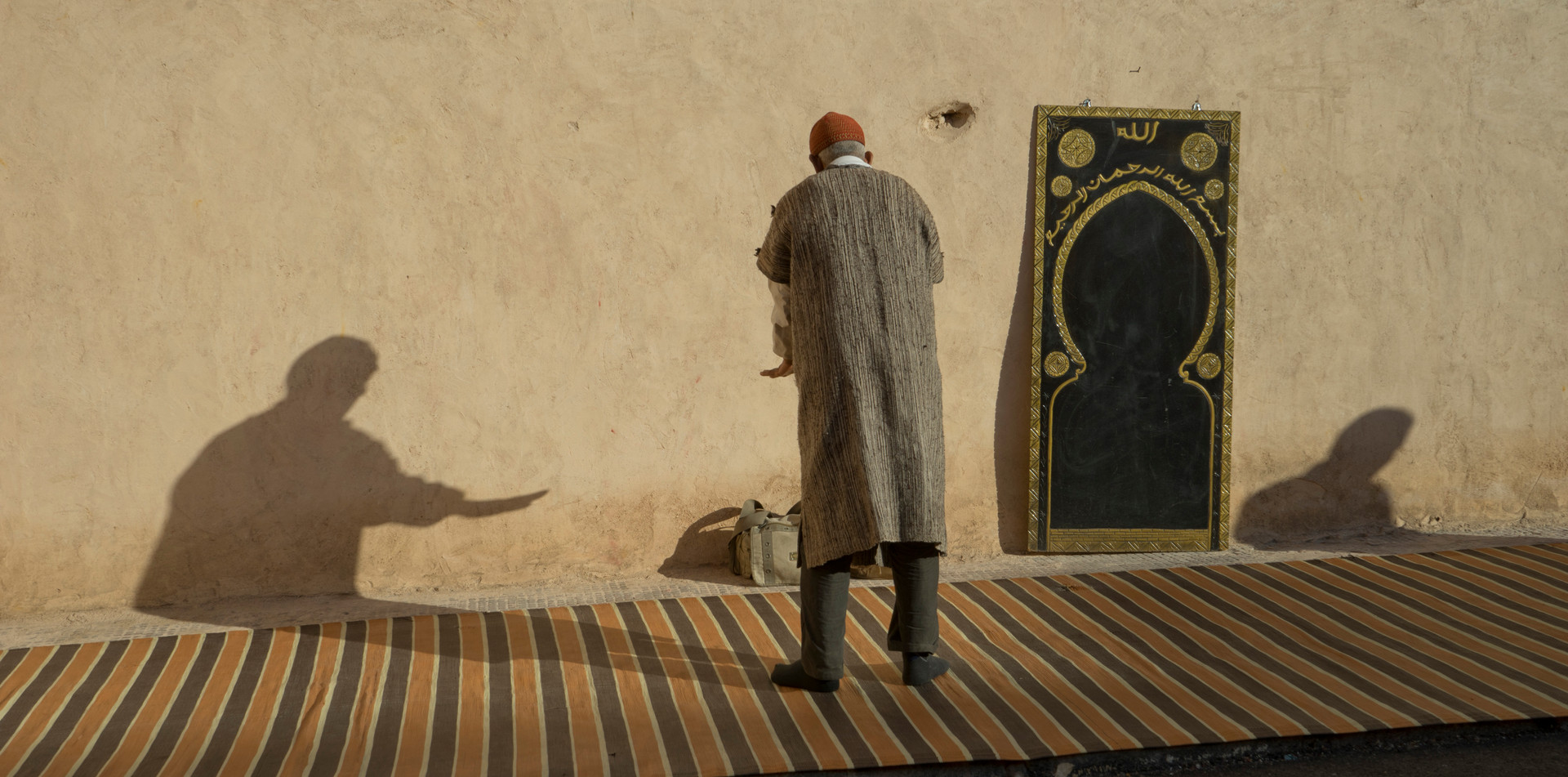 Muslim man praying in Marrakech during Ramadan