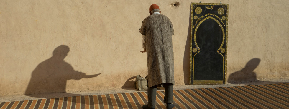 Muslim man praying in Marrakech during Ramadan