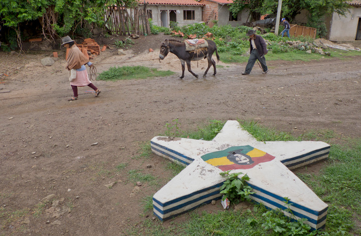 Local family walking past the school in La Higuera, Bolivia, where Che Guevara was killed after being taken prisoner