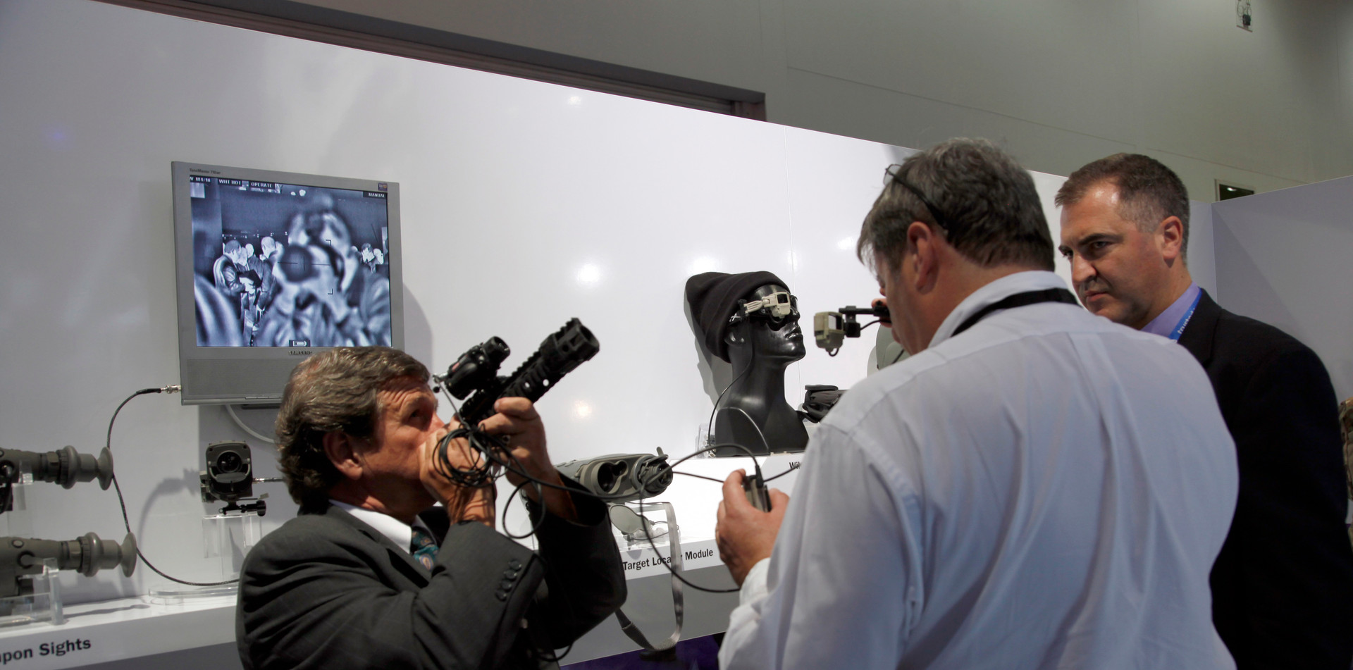 Visitors and traders at the Defence and Security Equipment International exhibition in London, UK