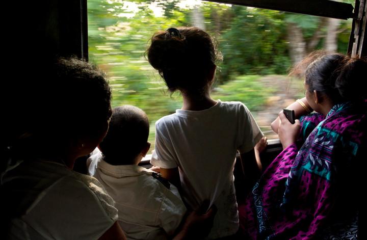 Passengers on a train along the 'Tsunami coast' in Sri Lanka